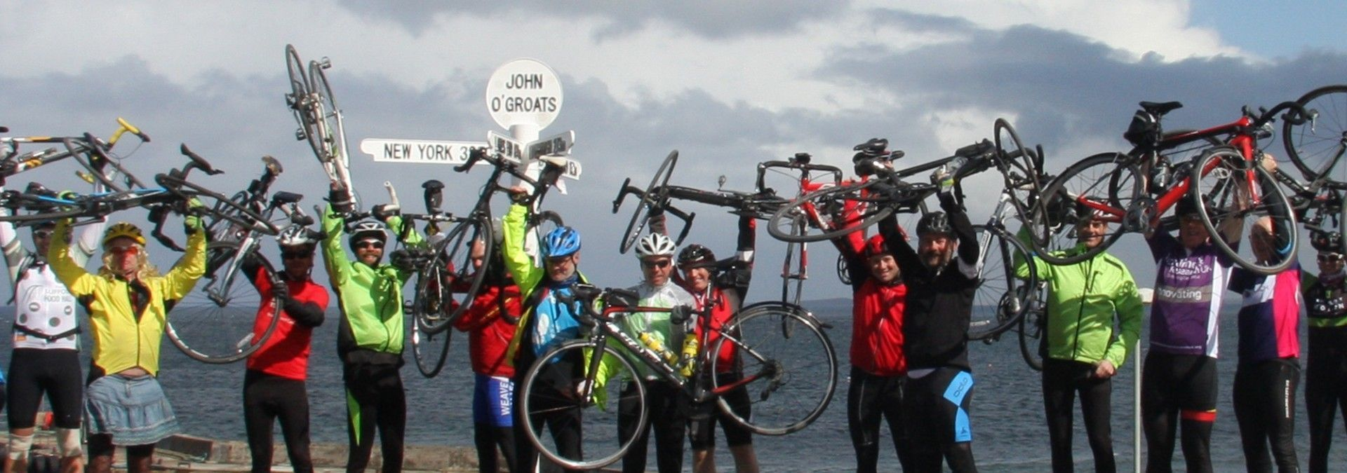 Charity_cyclists_celebrating_at_John_O_Groats.jpg