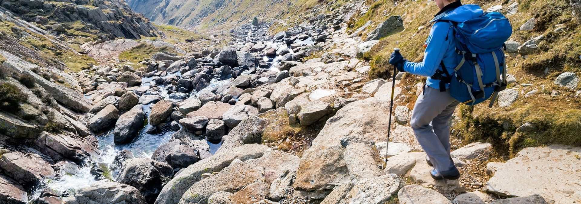 Trekking_with_poles_over_rocks_Lake_District.jpg