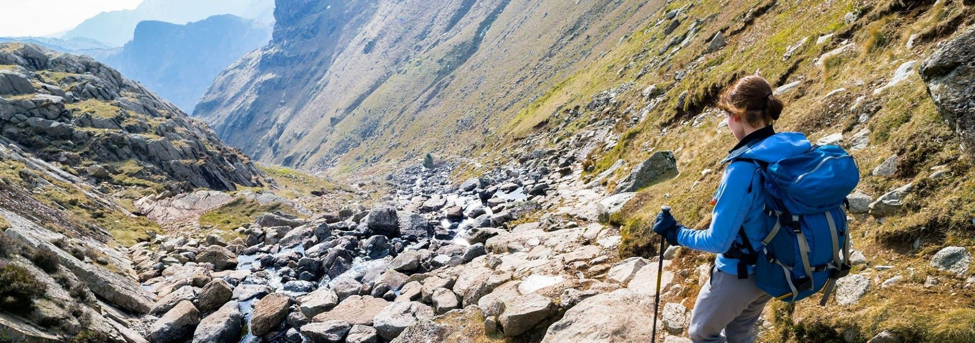 Trekking with poles over rocks in the Lake District