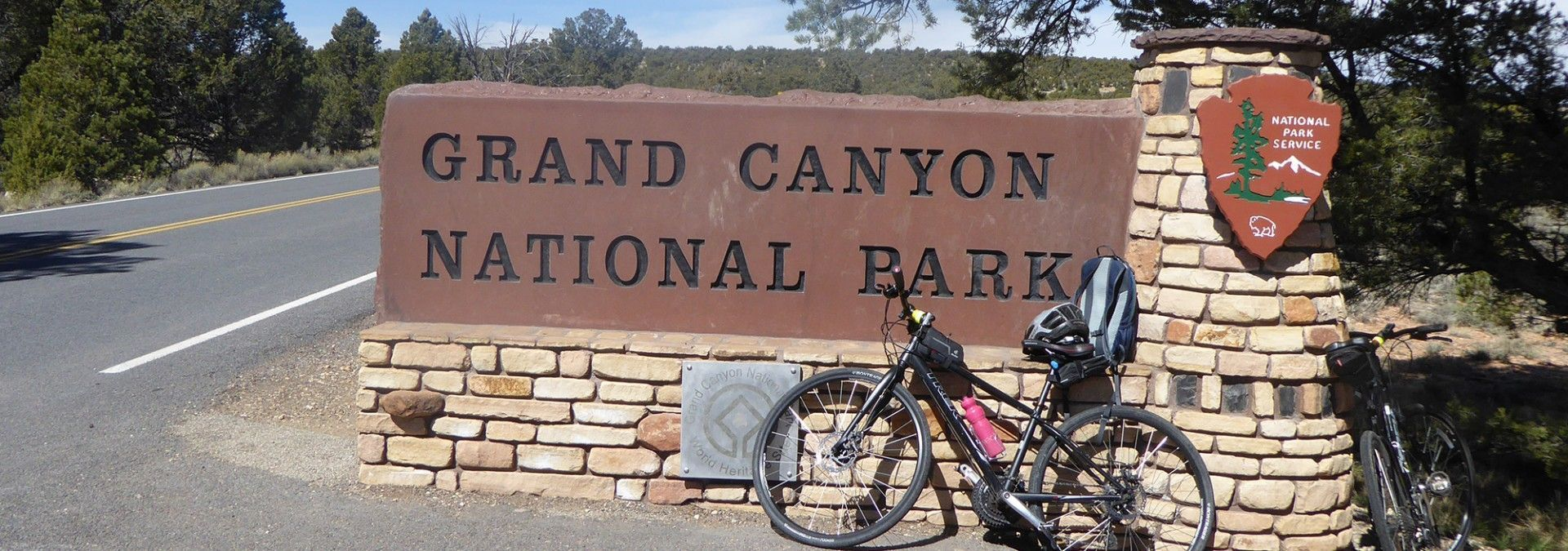 Bike_leaning_against_Grand_Canyon_National_Park_Sign.jpg