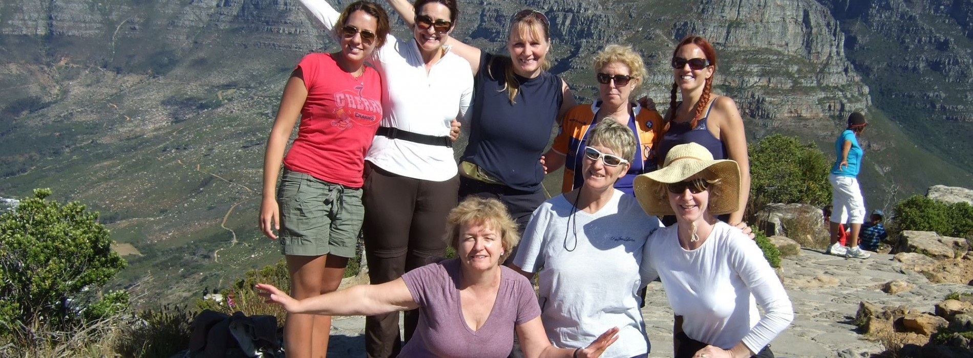 Charity_trekkers_celebrating_infront_of_Table_Mountain (2).jpg