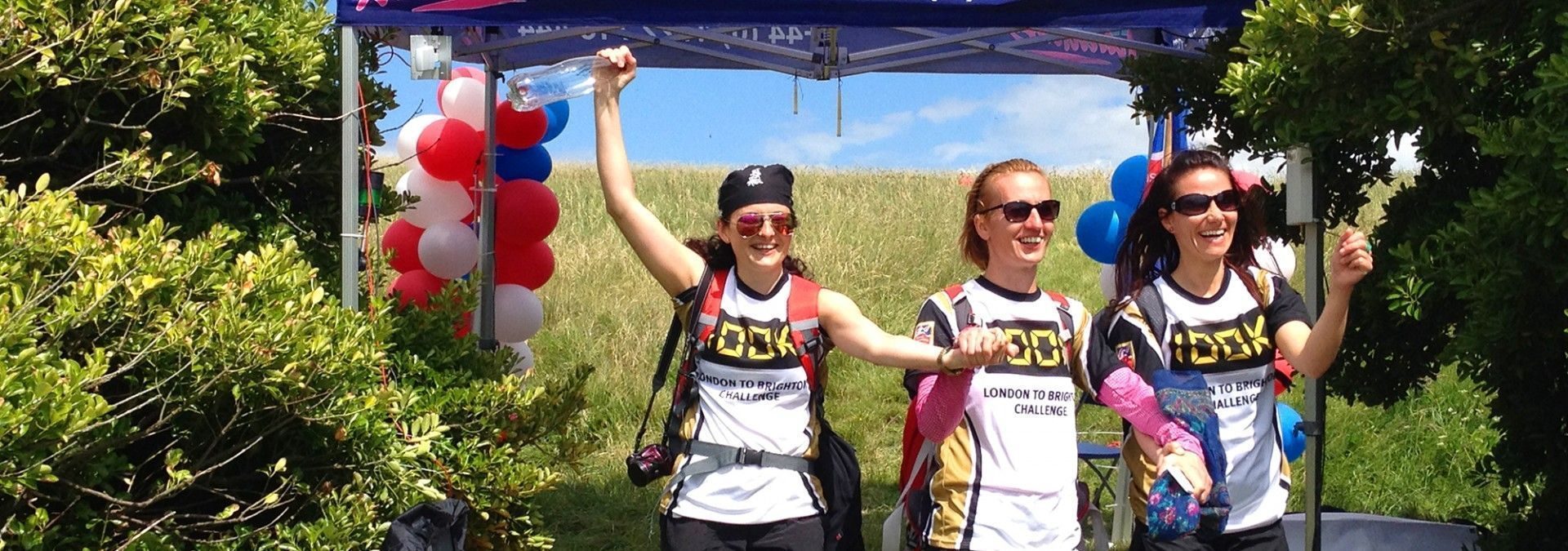Challengers_crossing_finish_line_Blind_Veterans_100k.jpg
