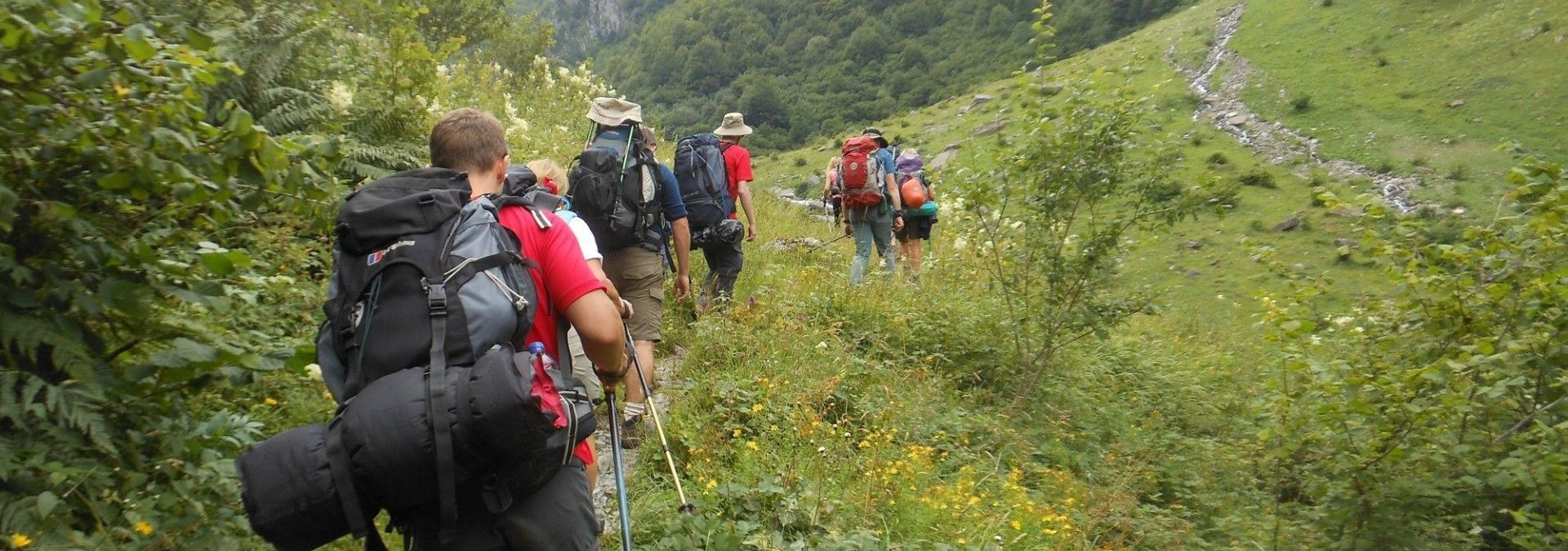 Using trekking poles to help on those demanding uphill climbs in the Pyrenees