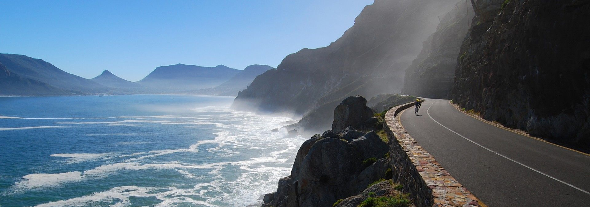 Cyclist_on_coastal_road_South_Africa.jpg