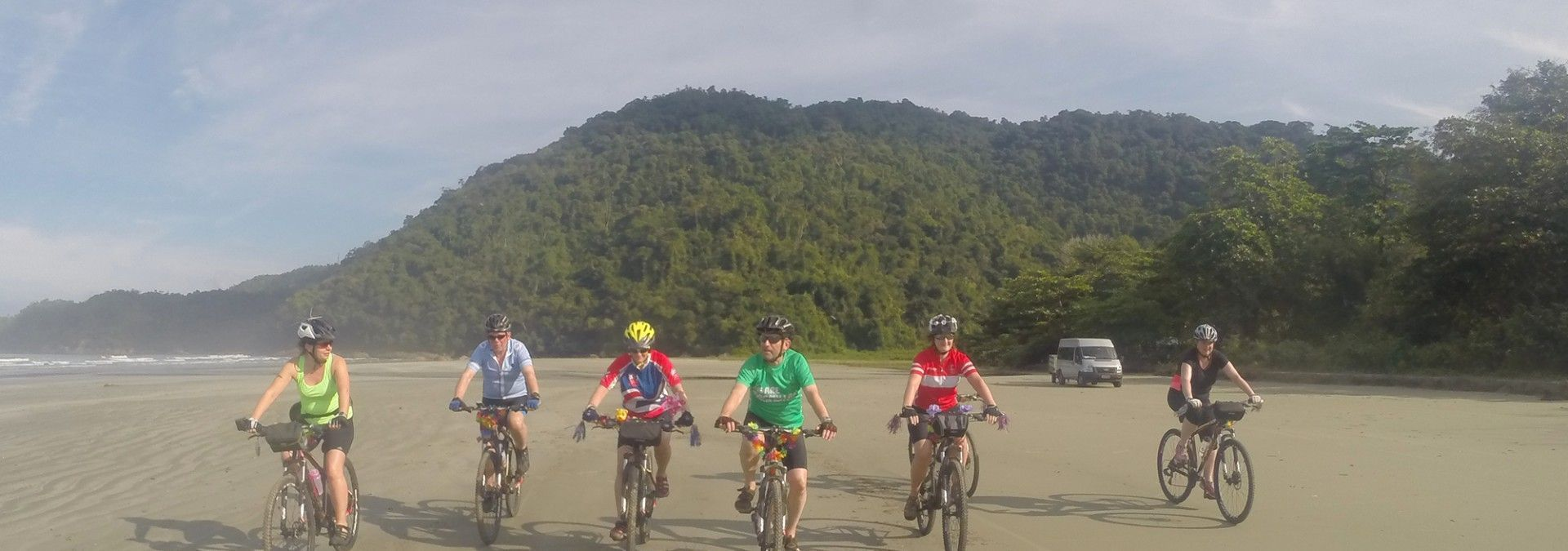 Cyclist_crossing_beach_Brazil.jpg
